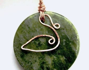 Connemara marble ornament with copper swan charm. Legend of Lir