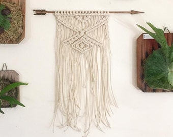 Wooden arrow macramé wall hanging.