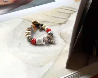 RESERVED Trade Wind, Bracelet with Artisan Lampwork, Stoneware, Antique Glass and African Metal Beads On Waxed Buckskin Leather