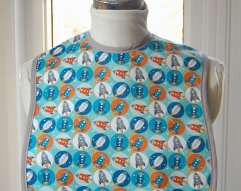 Blue Rockets - Small Reversible Fabric Adult Bib - fun cotton print with solid light grey lining - inner absorbent flannel layer
