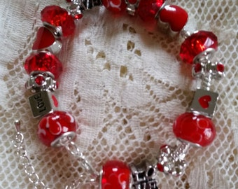 Love is all You Need Glass Bead Love Themed Charm Bracelet Handmade