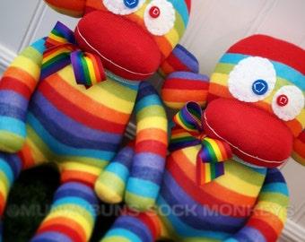 Rainbow Sock Monkey Doll with Rainbow Ribbon Bow tied around neck