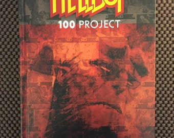 Hellboy 100 Project hardcover, signed and sketched in by Lucy Bellwood