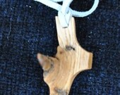 Cross from oak branch with knot