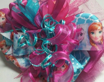 Over the top/sassy/boutique frozen hair bow on clip.  One of a kind.  Several different ribbons and lace used to make this sassy bow.