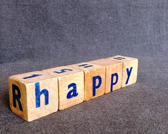 Be happy. Vintage wooden blocks message puzzle decor.