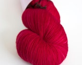 Red hand-dyed fingering weight yarn   Round Table Yarns Gawain in Morgan le Fay