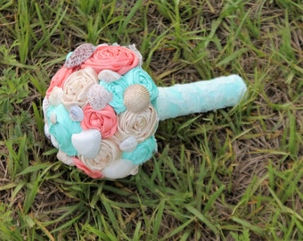 Seashell rosette bouquet. coral, turquoise, champagne fabric wedding bouquet. Beach wedding theme.