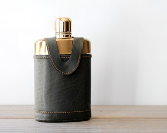 Vintage glass leather flask / man cave decor / masculine home decor / retro collectible glass bottle flask / gold color cap top clear glass