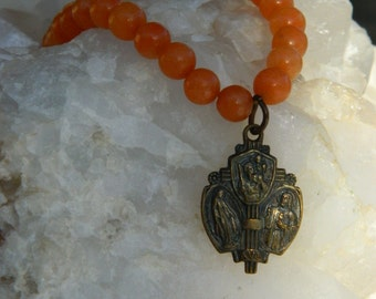 VINTAGE FRENCH MEDAL vintage repurposed assemblage bracelet handmade stretch jewelry miraculous  catholic orange glass bead atelier paris