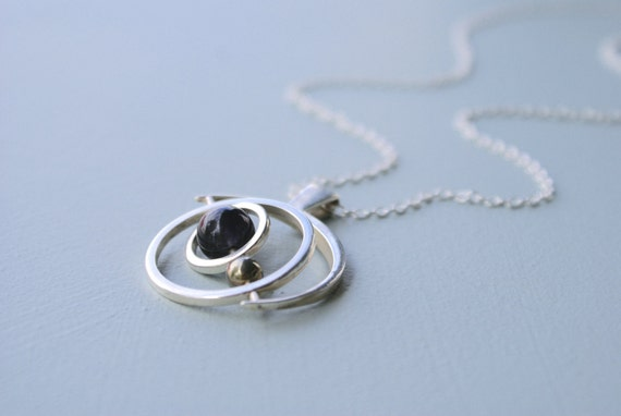 the Saturn Gryoscope necklace - tigers eye sphere