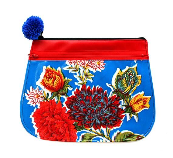 Clutch, oil cloth, blue floral, red vinyl, pom pom, zipper top, vegan