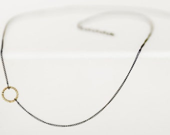 oxidised silver necklace with golden eye