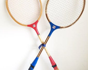 Pair of red and blue vintage badminton rackets
