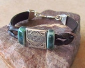 Twisted Leather bracelet with porcelain slider beads, Southwestern antique silver slider and S-clasp clasp