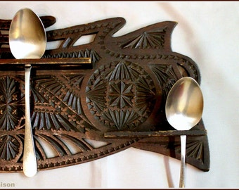 1900s two piece chip carved Arts and Crafts Frisian spoon rack.