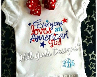 "Girl's ""Everyone Loves an American Girl"" patriotic ruffled shirt with monogram"