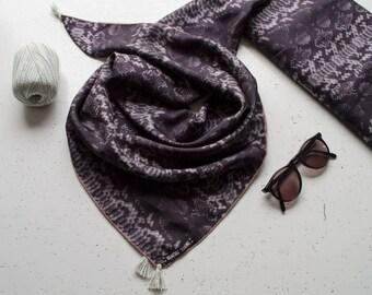 Silk scarf with pom poms