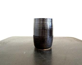 Striped black and tan ceramic cup, tumbler