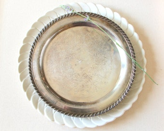 Vintage silver plated round plate made by WM A Rogers