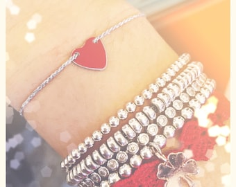 Bracelet with cord and enameled red heart