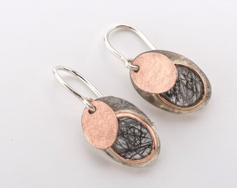 Earrings with rutile crystals in pink gold