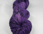 Hawkeye: 400 yards 100% Superwash Merino fingering weight yarn in Elemental yarn base.