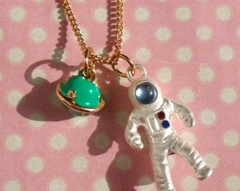 Kitsch Astronaut and planet necklace