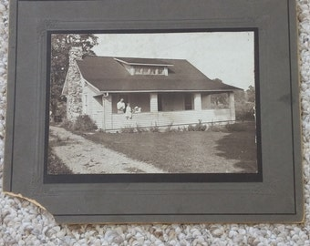 Vintage photo of family and house