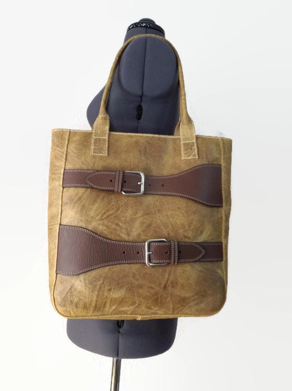 Items similar to distressed tan leather tote with Repurposed leather belts