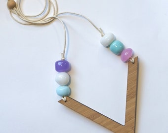 Pastel blues, pink and purple lamp-work glass beads with wooden V pendant necklace