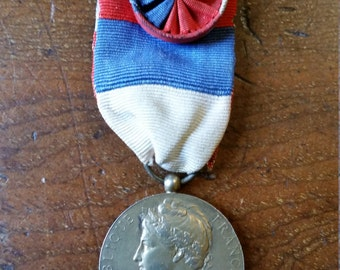 French Medal of Honour for Labour, silver gilt with rosette, Named D. Tilly 1930