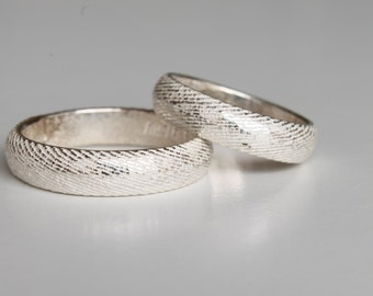 Silver wedding rings made with the melting with cuttlefish bone