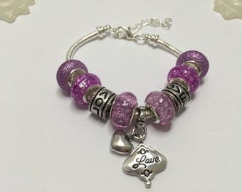 "Bracelet charm's fuschia with charms and charm ""love"" ref 694"