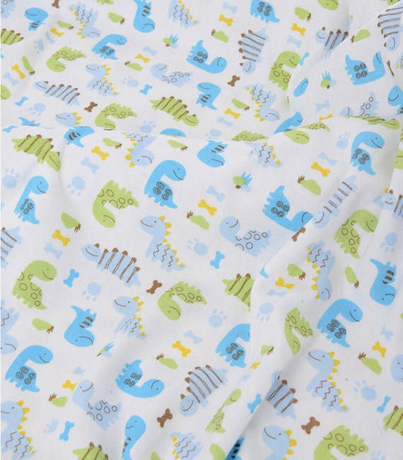 Cute baby knit fabric blue and green dinosaur knit by for Baby dinosaur fabric