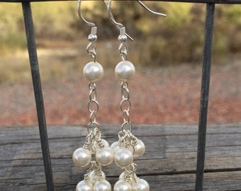 Pretty pearl and sterling silver dangle earrings made with Swarovski crystal pearls and sterling silver ear wires