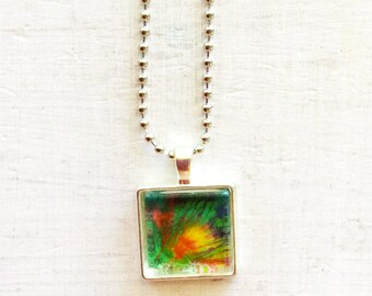 Small pendant necklace with abstract green and orange design