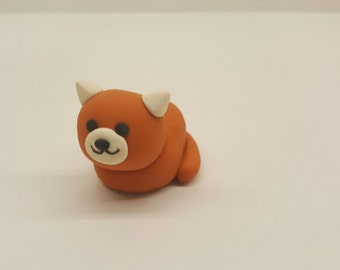 Orange and White Loafing Kitty Figurine