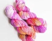 wild child / serendipity skein / hand dyed yarn / superwash merino wool sock yarn / pink red fuschia orange grey / speckle yarn / super soft