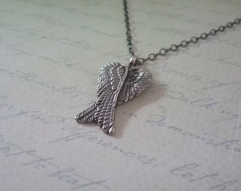 Silver-tone and gunmetal wings necklace