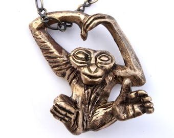 Monkey necklace, ape gibbon orangutang