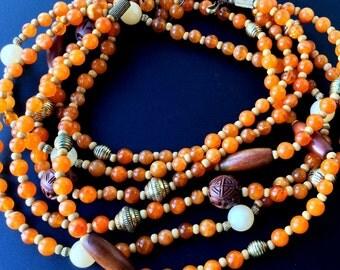 Vintage Avon Three Strand Necklace - Orange and Brown Beads