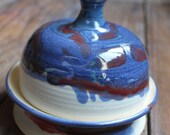 Handmade stoneware pottery ceramic butter dish in rich blues, white and a splash of red