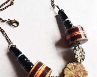 "21"" inch necklace: Flower shaped Soapstone, Metal Disks, Wooden beads, and Black Glass Beads with Copper Chain"