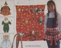 "Simplicity 7695. Tote organizers, apron, sleeping bag and clothes for 9"" (23 cm) bean bag animals. Pattern is uncut and factory folded."