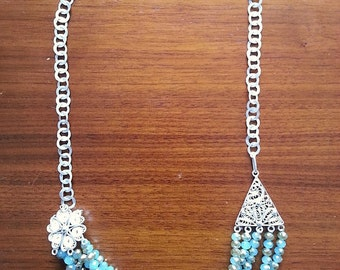 Sterling silver necklace and blue beads