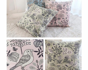 Cushion cover. Bird and flower