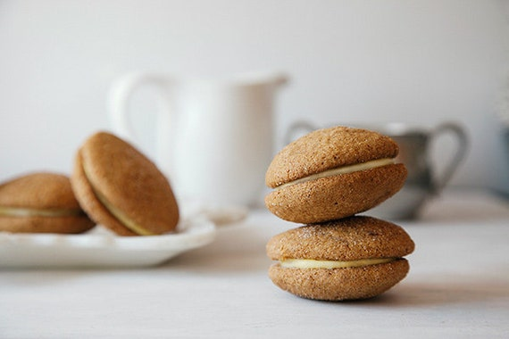 Pumpkin Ginger Sandwich Cookies with White Chocolate Filling
