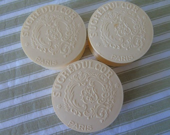 Trio of French vintage Sucreducor boxes.  Attractive embossed lidded boxes from the 1940s.