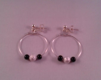 Earrings with silver and black beads on 25mm silver plated hoops